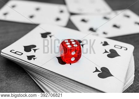 Red Dice Lie On A Deck Of Cards In A Casino. Casino Gambling With Dice And Cards