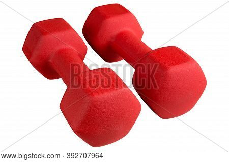 Pair Of Large Red Dumbbells With Textured Surface, On A White Background
