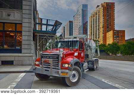 New York City, Usa, September 12, 2017 : A Red Construction Truck Turns In A Street Of Manhattan. Ma