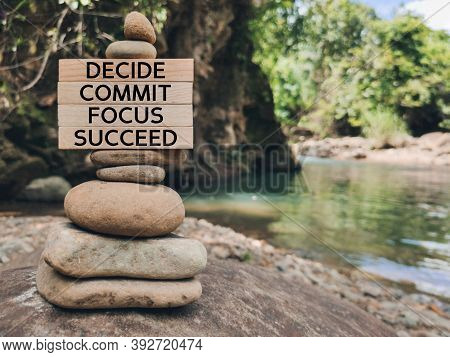 Inspirational And Motivational Words Of Decide Commit Focus Succeed On Wooden Blocks Background.