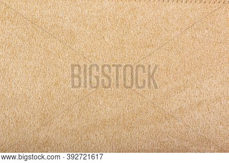 Light Beige Matte Background Of Suede Fabric, Closeup. Beige Suede Soft Leather As Texture Backgroun