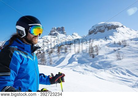 Alpine Skier Stand On Slope In Winter Mountains Dolomites Italy In Beautiful Alps Cortina D'ampezzo