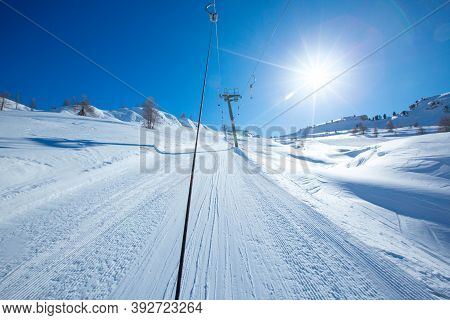 T Bar Ski Lift For Pulling Skiers Up The Slope. Perfect Winter Landscape In European Alps Italy Cort