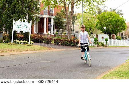 Johannesburg, South Africa - September 11, 2010: Young Boy Riding A Bmx Bike On Street Of Wealthy Ga