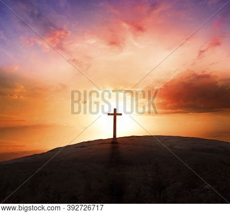 Good Friday Concept: Silhouette Cross On  Mountain Sunset Background