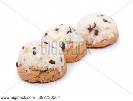 Confectionery with coconut flakes and chocolate chips isolated on white background