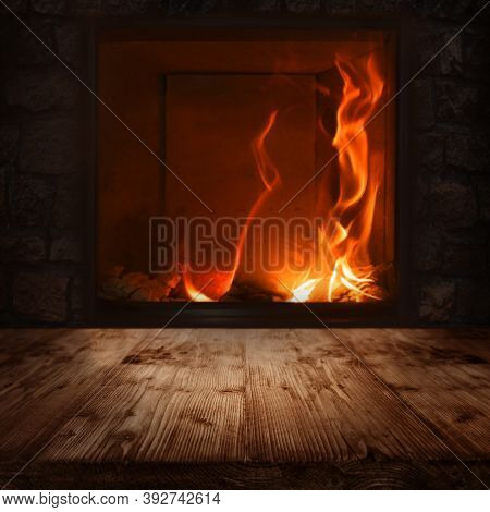 Illuminated Empty Wooden Table With A Fireplace. Square Dark Background For Cozy Living Concepts. Sp