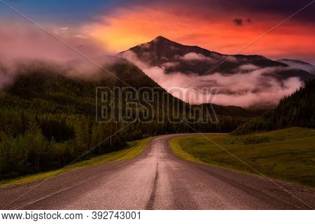 Beautiful View Of A Scenic Road, Alaska Hwy, In The Northern Rockies During A Sunny And Cloudy Morni