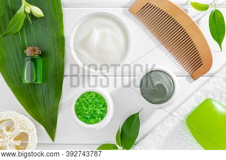 Organic Spa Products, Body Care Accessories And Green Plants On White Wooden Background. Flat Lay, T