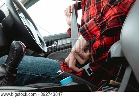 Asian Man Sitting On Car Seat Fastening Seat Belt Before Driving For Safety Preventing The Danger Of