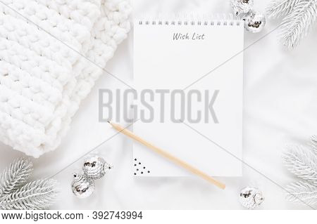 Christmas Decorations And Notebook With Wish List Or Goals And Dreams On White Background. Flat Lay,
