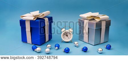 Boxes With Gifts And Christmas Tree Blue Toys With Clock On Blue Background, Christmas Holidays Time