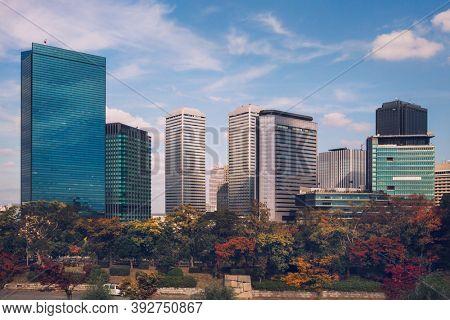 Autumn skyline of Osaka Business Park, viewed from Osaka Castle Park, Osaka, Japan