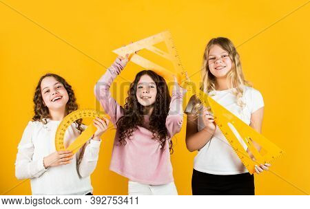 Inspired To Work Hard. Three Girls With Protractor And Triangle Ruler. Back To School. Geometry Favo