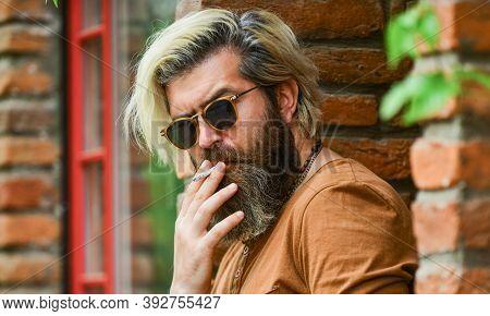 Handsome Man Unshaven Face. Fashionable Mature Man Smoking Cigarette. Punk Hipster Man Smoking. Smok