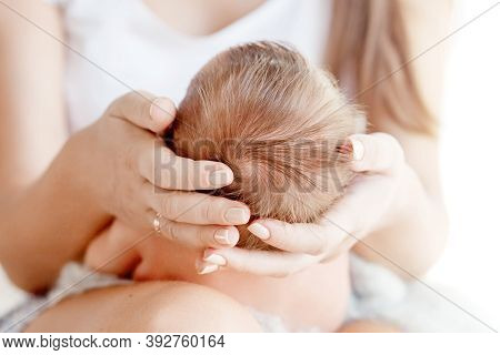 Mother Holding Head Of Her Newborn Baby In Hands. The Baby On Hands At Mum. Loving Mother Hand Holdi