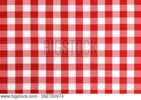 Red Checkered Textile Picnic Tablecloth Pattern In Close-up. Classic Italian Cuisine Style.