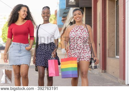 Happy Group Of Friends Shopping In Spring And Summer Season. A Picture Of A Group Of Happy Girls Sho
