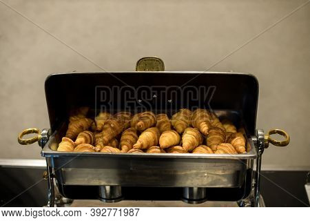 Pile Of Fresh Baked Mouthwatering Almond Croissant Pastries In The Basket. Fresh Baked Croissants .