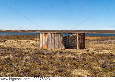 Falkland Islands, Uk - December 15, 2008: Wide Windswept Bare Landscape Of Dry Land With The Remains