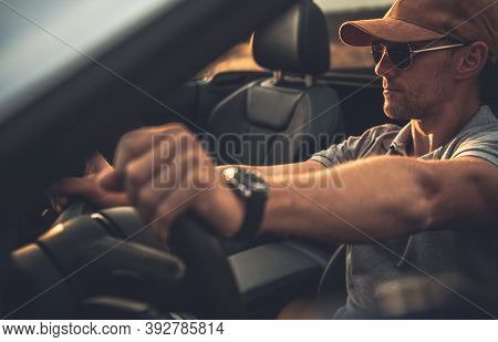 Caucasian Men Behind The Wheel. Driver In His 40s On The Road Trip In His Cabrio Vehicle. Transporta