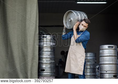 Startup Of Beer Business And Work At Factory During Covid-19 Epidemic. Young Handsome Male Brewer Or