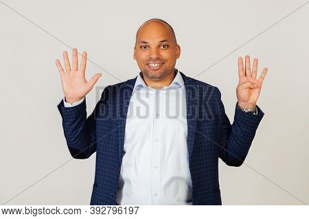 Portrait Of Successful Young African American Businessman Guy, Showing With Fingers To Number Nine,