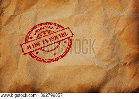 Made In Israel Stamp Printed On Crumpled Sheet Of Burnt Paper. Jewish Product, Parcel, Package, Prod