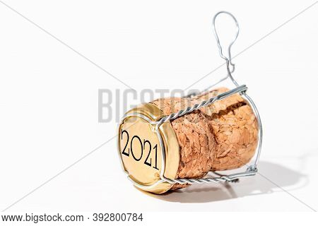 Close-up Of A Champagne Cork With Its Cage On A White Background. Cork Has A Date Of 2021