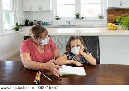 Stressed Mother Helping Bored Daughter Studying Online Lesson At Home. Parent And Child With Face Ma