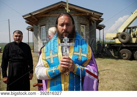 July 11, 2020, Russia, Magnitogorsk. An Orthodox Priest Conducts A Prayer Ceremony Next To A Small C
