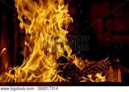 A Bonfire Burns Of Flames Hot Fireplace Burning Wood Of Dry Firewood