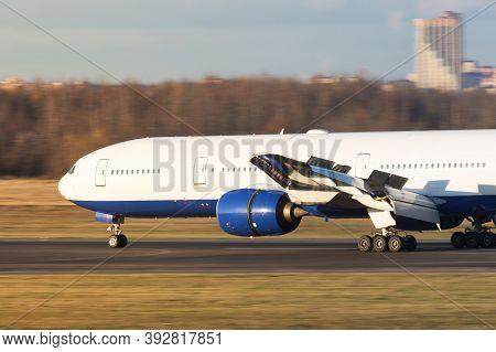 Reverse Of Aircraft Engines During Landing. Engine With Active Thrust Reverse. Fast Moving Airplane.