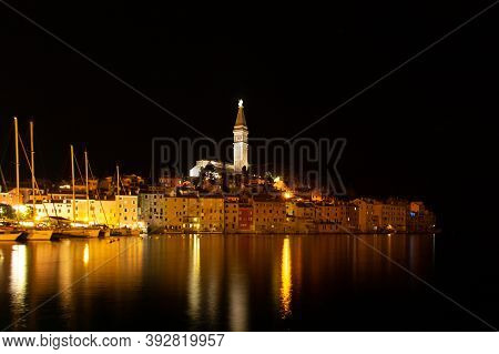 Rovinj,istria,croatia.view Of Night City Situated On The Coast Of Adriatic Sea.popular Tourist Resor