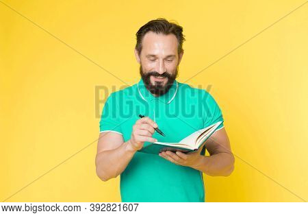 Helpful Checklist. Man Mature Bearded Guy Writing Notes To Notepad. Check What Is Done. Daily Schedu
