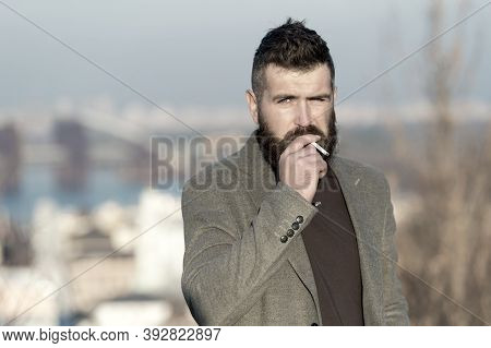 Smoking Devices Concept. Bearded Hipster Smoking Outdoors. Device Hide Conceal Smell Of Smoke. Hands