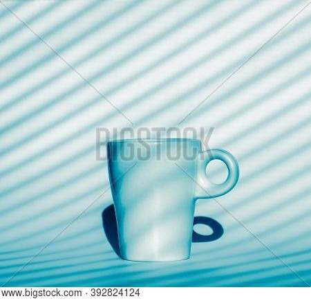 Single Coffee Cup On Blue And White Background