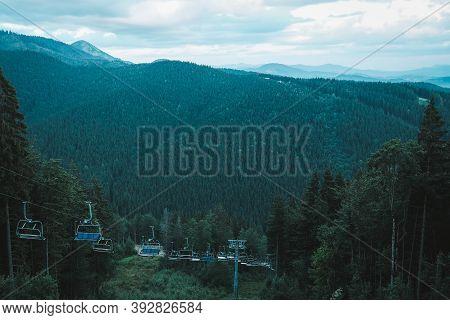 Bukovel, Ukraine - July 2020: Ski Lift Moving Upward In The Carpathian Mountains During Summertime.