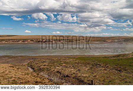 Falkland Islands, Uk - December 15, 2008: Wide Windswept Bare Landscape Of Dry Land With Low-tide Ba