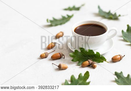 Cozy Still Life With A Cup Of Coffee, Oak Leaves And Acorns On A White Background. Acorn Coffee. Caf