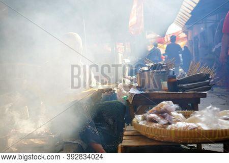 Yogyakarta, Indonesia. September 6, 2018: Chicken Satay Seller Grilling Satay At Niten Market, Yogya