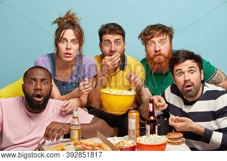 Photo Of Five Mixed Race Woman And Men Watch Thriller Movie, Horrible News, Look In Panic, Eat Popco