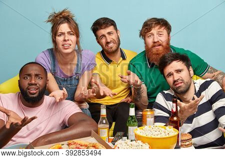 Annoyed Discontent Friends Irritated With Too Much Television Advertising, Gesture With Apathy, Have