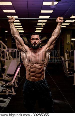 Strong Athlete Man Holding Crossbar In Night Gym