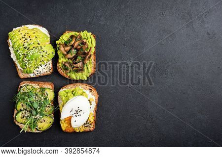 Set Of Avocado Toasts With Different Toppings. Vegetarian Avocado Toast With Egg, Fried Mushrooms, C