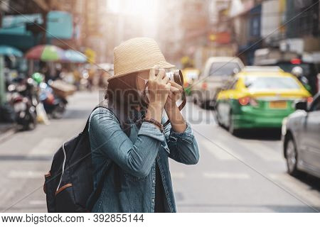 Asian Women Wearing Surgical Face Mask Traveler With Camera Travel Of Lifestyle Portrait , Outdoor S