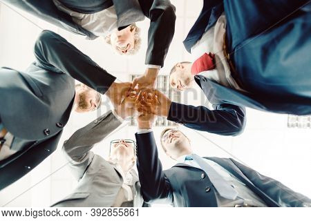 Business team starting a new project together during teambuilding