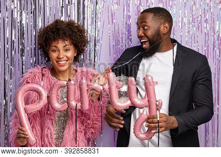 Optimistic Guy With Beard Wears Elegant Suit, Looks Happily At Girlfriend, Celebrate Something, Pose