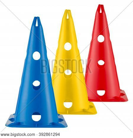 Three Colored Sports Or Road Cones, Blue, Yellow And Red, Stand On A White Background