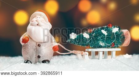Merry Christmas Or Happy New Year Greeting Card. Decorated Toy Christmas Tree On White Sleigh Carrie